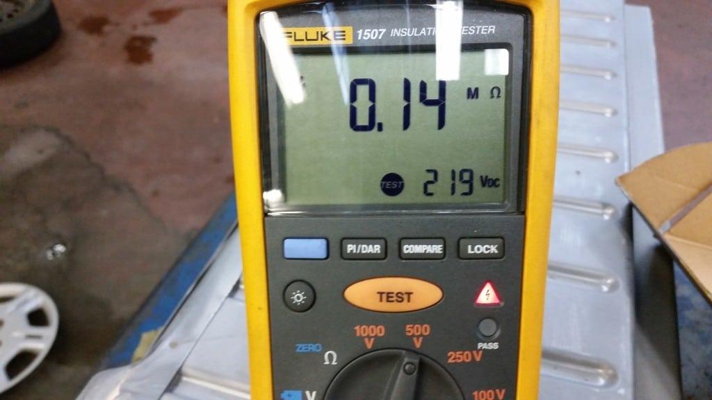 Megger or insulation test meter displaying 0.14 Megohms