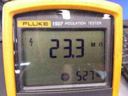 Insulation test meter screen reading 23.3 megohms