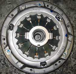 clutch release bearing on top of a pressure plate on top of a disc on top of a flywheel