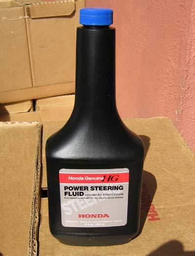 genuine Honda power steering fluid in a small bottle
