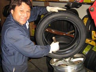 man applying lube to bead of tire