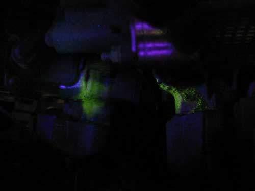 ultraviolet leak detection dye glowing on hybrid motor