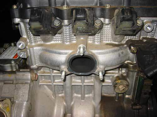 Honda hybrid cylinder head with integral exhaust manifold