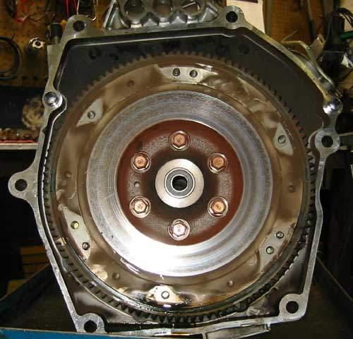 honda hybrid flywheel covered with clutch dust