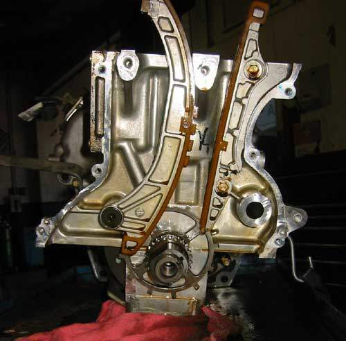 Honda hybrid cylinder block stripped with timing chain guides exposed