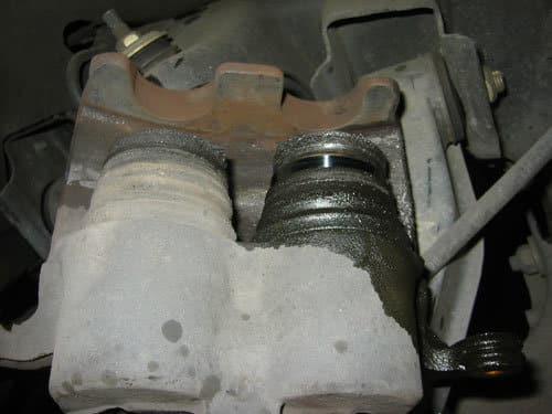 leaking brake caliper with piston hyper-extended