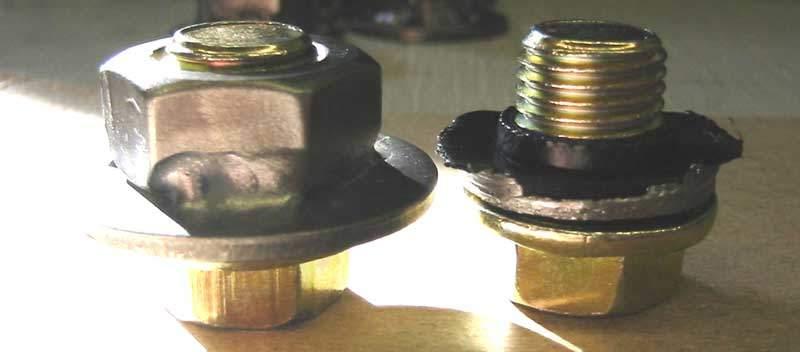 Improved Honda oil pan drain plug threads next to original drain plug threads