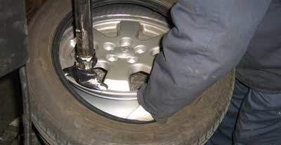 removing a tire from a rim