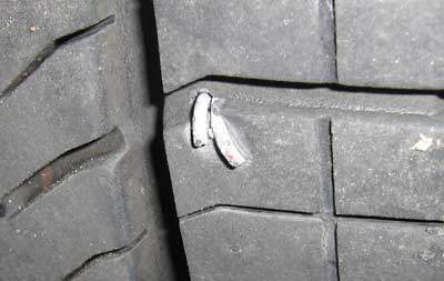 staple stuck in tire