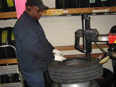 man mounting a tire