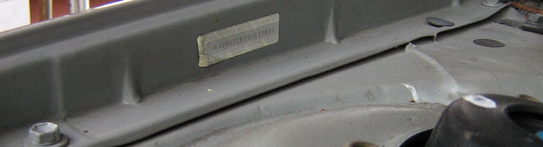 VIN tag on inside of fender under-hood