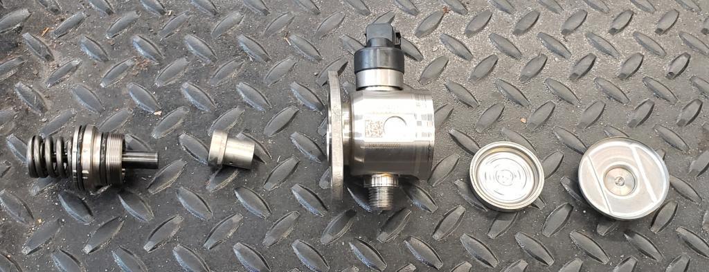 disassembled honda direct injection fuel pump
