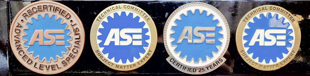 a certified mechanic toolbox with ASE medallions