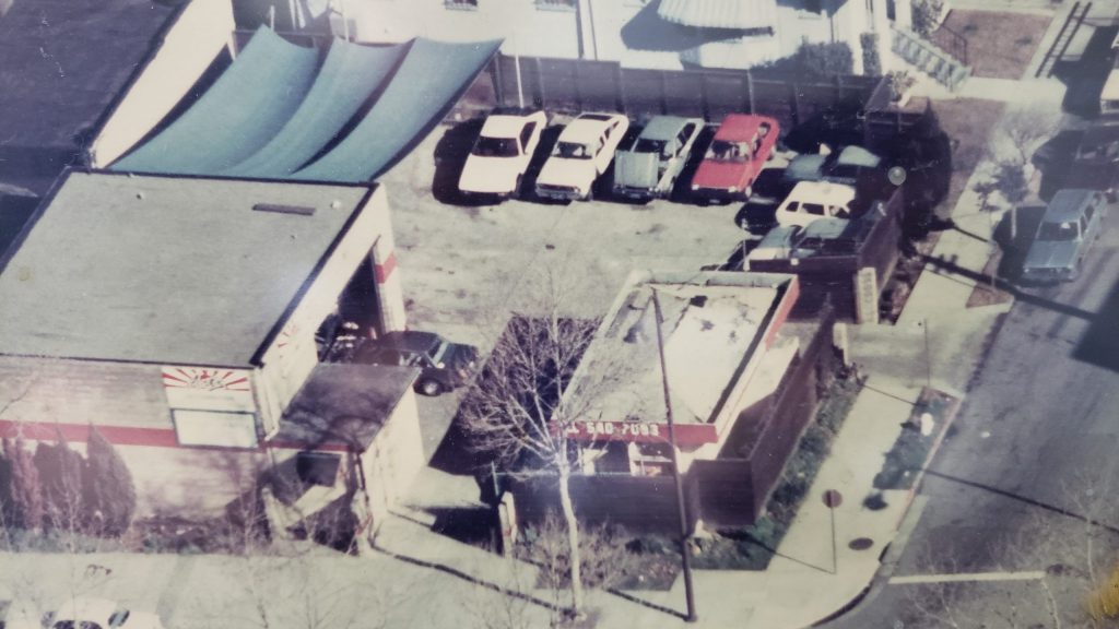An ariel view of Art's Automotive from 1985 with vintage Japanese cars