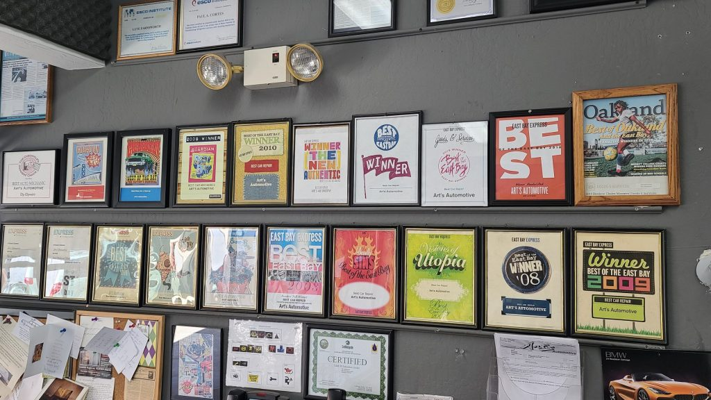 """A wall in the office with many """"best of the bay"""" awards from several print publications"""