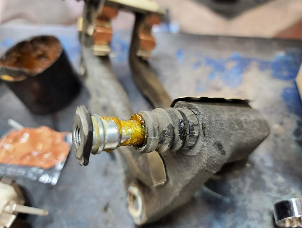 caliper pin greased with silicone grease