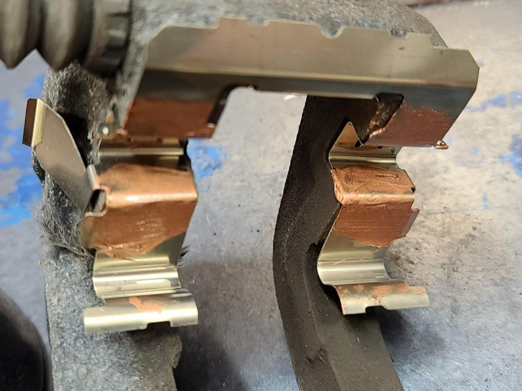caliper bracket slider with copper grease applied
