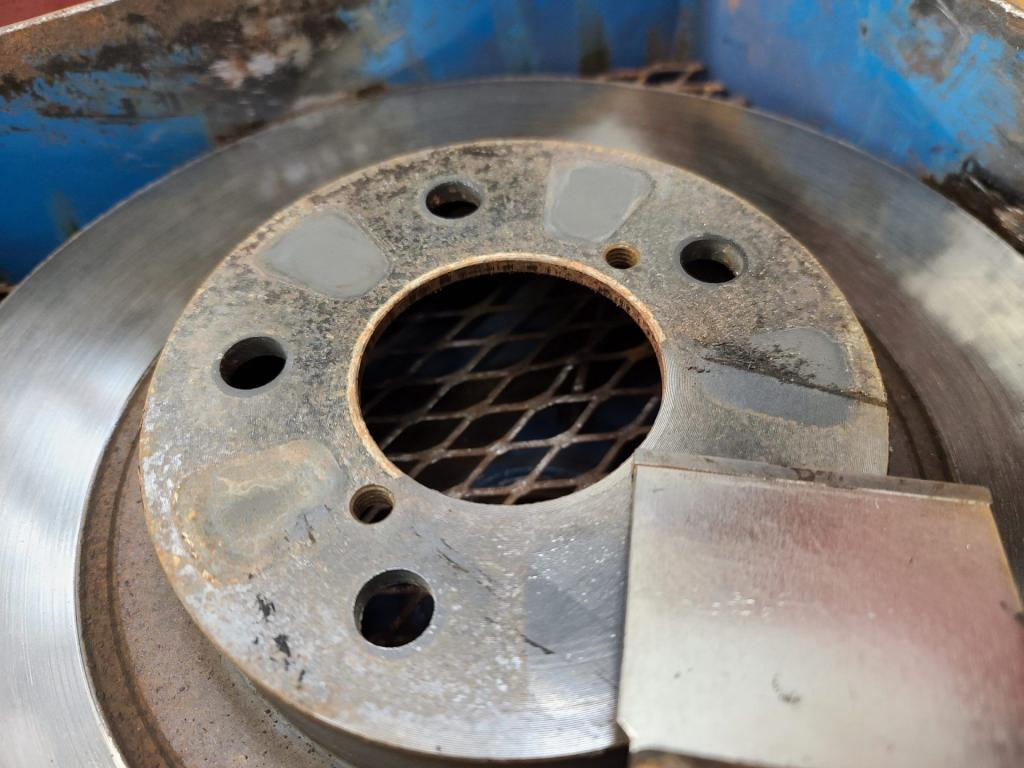 scraping corrosion from rotor hub face surface