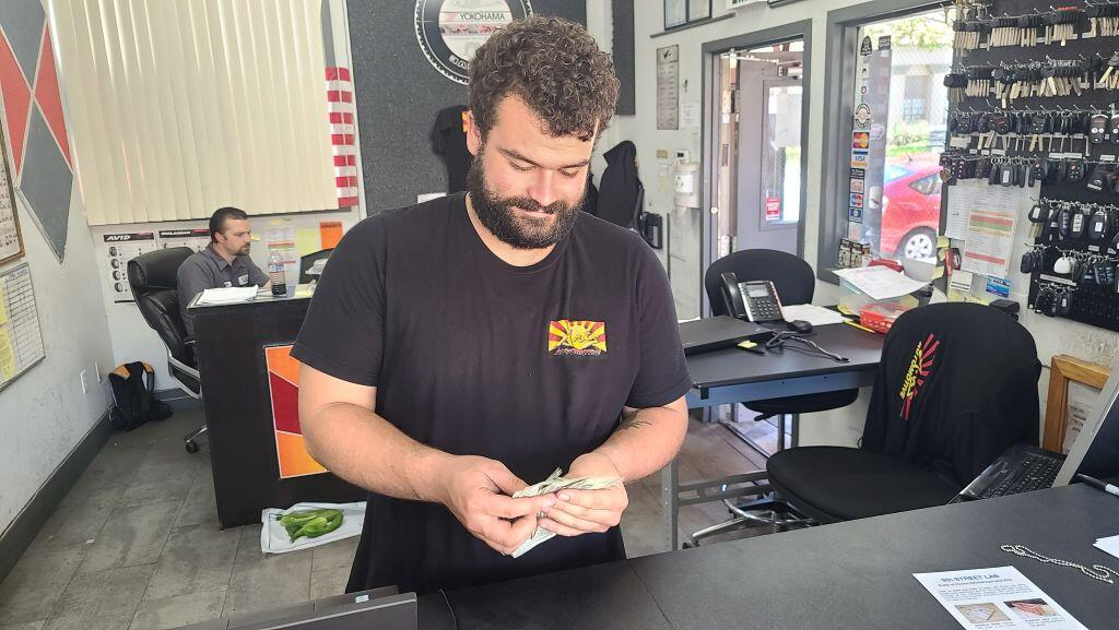 Mechanic counting cash