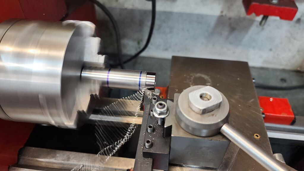 tube being machined in lathe