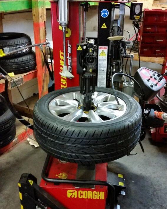 tire being installed on a fancy tire machine