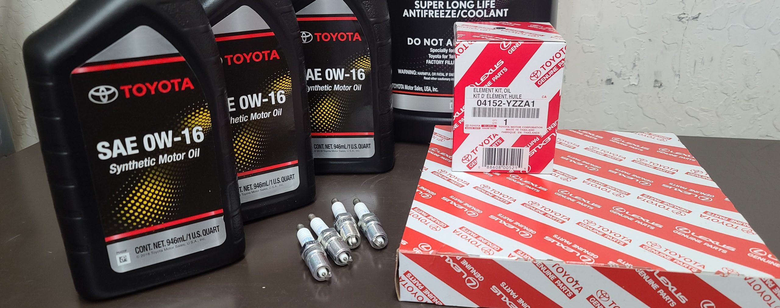 Toyota service parts: oil filter, air filter, spark plugs, and motor oil